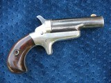 antique colt 3rd model thuer derringer early s/n 892 matching. excellent 100% silver. 75% blue..