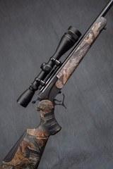THOMPSON/CENTER Encore .223 rifle + 12 gauge combo.
