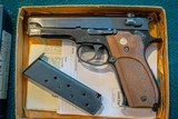 Smith & Wesson Model 39 -9mm 1971 with extra magazine and original box and papers
