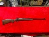 Remington 700 custom shop 375 H & H mag