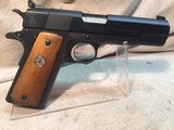 colt conversion unit in .22 long rifle caliber on top of essex arms corp 1911 frame