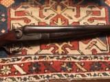 Ithaca 12 ga hammer gun on 10 ha frame