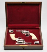 2 Colt SAA Sheriff's Model. 44/40. 3 Inch. Engraved Nickel Finish. Rare Consecutive Pair. Excellent Condition. In Colt Wood Case.