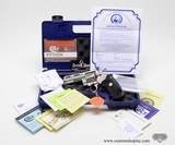 Colt Python .357 Mag. 4 inch. Bright Stainless Finish. Like New In Blue Case.
