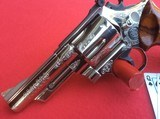 "SMITH & WESSON MODEL 29-2 4"" BARREL. NICKEL PLATED FACORY ENGRAVED"