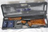 BERETTA DT-10 TRAP WITH FACTORY WOOD UPGRADE - 1 of 12