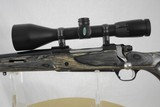 RUGER MODEL 77 MARK II - CUSTOM STOCK LEFT HAND WITH WEAVER EUROPEAN SCOPE