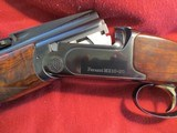 "Perazzi MX10 20, (20 gauge), 29.5"", choke tubed, 4 notch adjustable aluminum rib. 28ga and .410 Briley Tubes. Unicorn gun. - 1 of 15"
