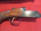 "Perazzi MX10 20, (20 gauge), 29.5"", choke tubed, 4 notch adjustable aluminum rib. 28ga and .410 Briley Tubes. Unicorn gun. - 4 of 15"