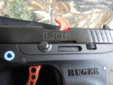 RUGERL.C.P.ALLNEW380CUSTOM ,COMES WITH AWIDE REDSKELTONIZED ALUMINUM TRIGGER,NEWINBOX - 4 of 13