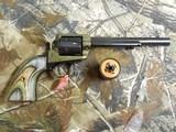 """HERITAGECOMBO,22-L.R, / 22 MAGNUM,( TWO CYLINDERS),6.5""""BARREL,6 - SHOT,BLUED/C. COLORED LAMINATE GRIP,FACTORYNEWINB - 5 of 21"""