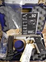 "BerettaJS92F520M 92 FS, Italy INOX, Single/Double, 9-MM Luger,4.9"" BARREL,2- 15+1 RDMAGAZINES,Black Synthetic Grip Stainless Steel"