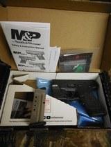 "Smith & Wesson, M&P 40 Shield M2.0, GREEN LASER & LIGHT, 40 S&W,3.1"" Barrel, 6+1 & 7+1 RD. MAGAZINES,Black Armornite Stainless Steel Slid, NE - 1 of 19"