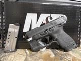 "Smith & Wesson, M&P 40 Shield M2.0, GREEN LASER & LIGHT, 40 S&W,3.1"" Barrel, 6+1 & 7+1 RD. MAGAZINES,Black Armornite Stainless Steel Slid, NE - 4 of 19"