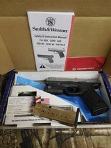 """Smith & Wesson 13051 SD40 VE Crimson Trace Rail Master 40 S&W 4"""" 14+1 Black Stainless Steel, Textured Polymer Grip"""
