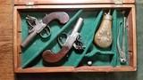 Mace & Evans Pair of Small Screw on Barrel Flintlock Pistols w/case Flask and Mold.