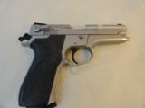 Smith & Wesson Stainless Model 5906 .9mm Semi Auto Pistol - 1 of 7