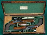 H. W. Mortimer --- Cased Pair Sidelock Flintlock Pistols --- .64 Calibre - 1 of 10