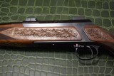 J.P. Sauer & Son Model 200 Bolt Action Rifle with Schmidt & Bender Scope, Carved Stock and Case - 7 of 23