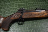 J.P. Sauer & Son Model 200 Bolt Action Rifle with Schmidt & Bender Scope, Carved Stock and Case - 16 of 23