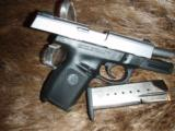 Smith & Wesson .40S&W Stainless Slide Polymer grip - 3 of 3
