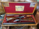 Boss & Co Best Quality Matched Pair with side lever opening ~ Super rare and beautiful!This listing shows pictures and data of gun number