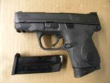 Smith & Wesson M&P9c Compact 9mm Para. w/Crimson Trace Laser Grips - 2 of 5