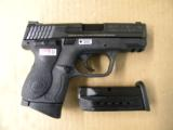 Smith & Wesson M&P9c Compact 9mm Para. w/Crimson Trace Laser Grips - 1 of 5