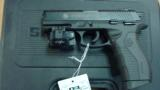 TAURUS PT809 9MM PISTOL W/ GREEN VIRIDIAN LASER MINT - 1 of 2