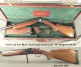 "PERAZZI TMS 12 SINGLE BARREL TRAP- 34"" STEPPED VENT RIB- 1980- 3 FACTORY SCREW CHOKES- ADJUSTABLE COMB- DETACHABLE TRIGGER- FACTORY TRUNK"