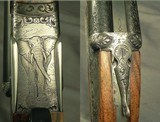 RIGBY 470 N. E. LONDON SIDELOCK EJECTOR- LONDON PROOF 1998- 90% COVERAGE of FLORAL & 3 AFRICAN GAME ANIMALS- EXC. WOOD- OVERALL REMAINS at 98%- CASED - 5 of 8