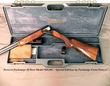 """PERAZZI 20- MX20C- PERAZZI/PACHMAYR SPECIAL EDITION- 1986- 35% ENGRAVING COVERAGE- 26"""" V R Bbls.- 6 FACTORY CHOKES- NICE WOOD- OVERALL 97% COND. - 1 of 8"""