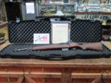 SPRINGFIELD ARMORY M1A NATIONAL MATCH 308CAL. STAINLESS BBL.99.5% IN ORIGINAL HARD CASE WITH MANUELS.