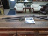 SPRINGFIELD TRAPDOOR MODEL 1873 RIFLE 45-70 GOV'T CAL. WITH BAYONET ,SCABBARD AND HARD COVER BOOK.