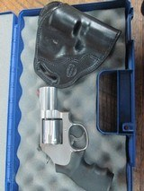 SMITH & WESSON MODEL 686-6 2 1/2 INCH BARREL 357 MAGNUM 6 SHOT STAINLESS WITH CUSTOM HOLSTER