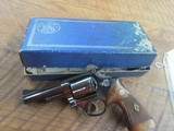 ORIGINAL SMITH & WESSON .357 COMBAT MAGNUM PRE MODEL 19 4 INCH BLUED WITH FACTORY LETTER AND BOX.