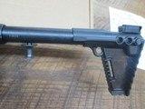 kel-tec sub 2000 glock 19 9mm semi auto rifle, folding stock. Glock mag - 6 of 8
