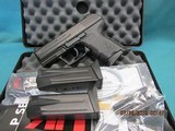 "Heckler & Koch P2000SK-V2 .40 S&W ""LE"" model with 3 mags & Night sights"