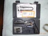 "Ruger Vaquero 45C/45ACP 5-1/2"" High Gloss SS Revolver"
