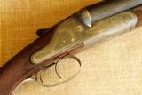"Chas. Lancaster ""Colindian"" Ball and shot gun."