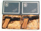 A CONSECUTIVE NUMBERED PAIR OF S&W MODEL 39 PISTOLS NEW IN THE BOX