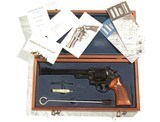 "SMITH & WESSON MODEL 27-2 WITH 8 3/8"" BARREL IN IT'S WOODEN PRESENTATION BOX"