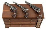 COLT PYTHON, SINGLE ACTION & DRAGOON BICENTENNIAL SET IN DISPLAY CASE WITH BOOK