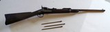 SPRINFIELD U.S MODEL 1884 TRAP DOOR CARBINE RIFLE WITH ORIGINAL CLEANING TOOLS