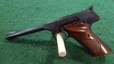 Colt. Model Woodsman semi auto pistol.