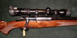 WINCHESTER RARE POST 64, MODEL 70, 7 MM REM MAG RIFLE - 1 of 5