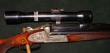 URBAS VINZENZ SIDEPLATE BLITZ ACTION DRILLING/COMBINATION GUN, 16GA/8 X 57JR, 22 MAG - 1 of 5