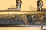 Remington M700 Stainless Camo 30-06 caliber with scope mounts