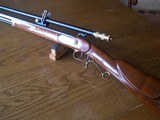 TCHawken Percussion 50 cal with SCOPE
