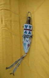 AMERICAN INDIAN FIGHTING KNIFE AND BEADED SHEATH